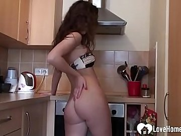 Desirable brunette teases in the kitchen on cam